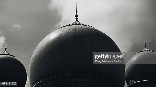 low angle view of dome of building against cloudy sky - putrajaya stock photos and pictures