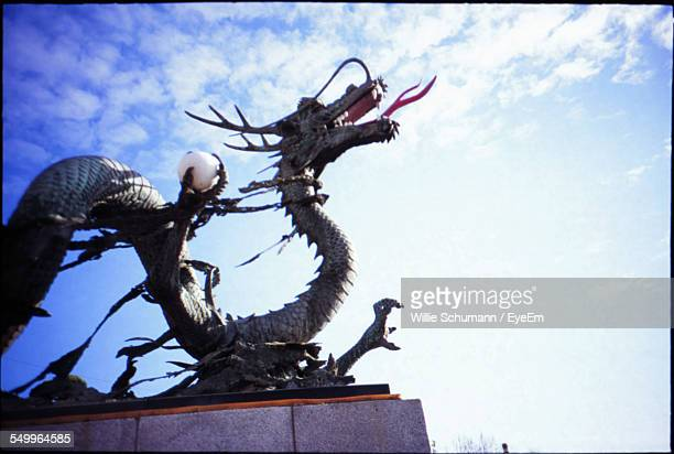 Low Angle View Of Dragon Representation Against Sky