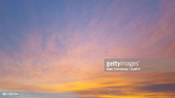 low angle view of dramatic sky at sunset - sunset stock pictures, royalty-free photos & images