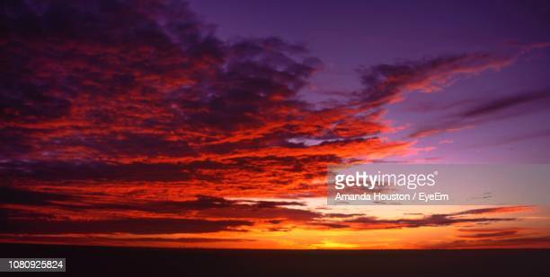 low angle view of dramatic sky during sunset - uluru stock photos and pictures