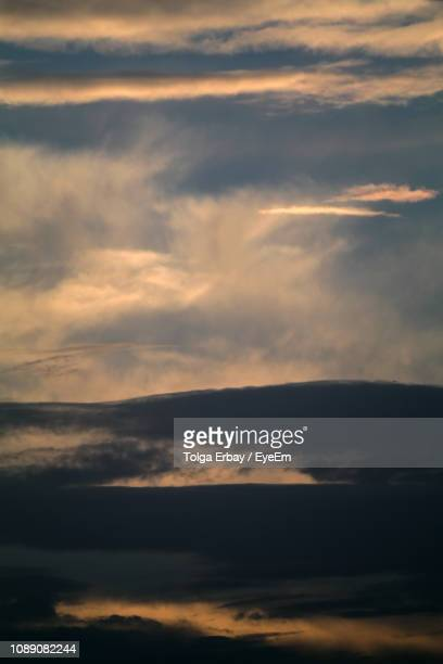 low angle view of dramatic sky during sunset - tolga erbay stock photos and pictures