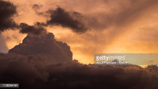 low angle view of dramatic sky during sunset - jesus calming the storm stock pictures, royalty-free photos & images
