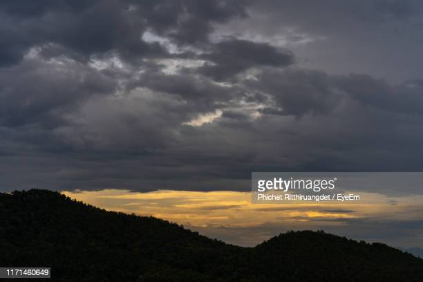 low angle view of dramatic sky during sunset - phichet ritthiruangdet stock photos and pictures