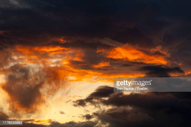 low angle view of dramatic sky during sunset - dark stock pictures, royalty-free photos & images