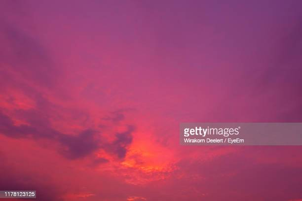 low angle view of dramatic sky during sunset - romantic sunset stock pictures, royalty-free photos & images
