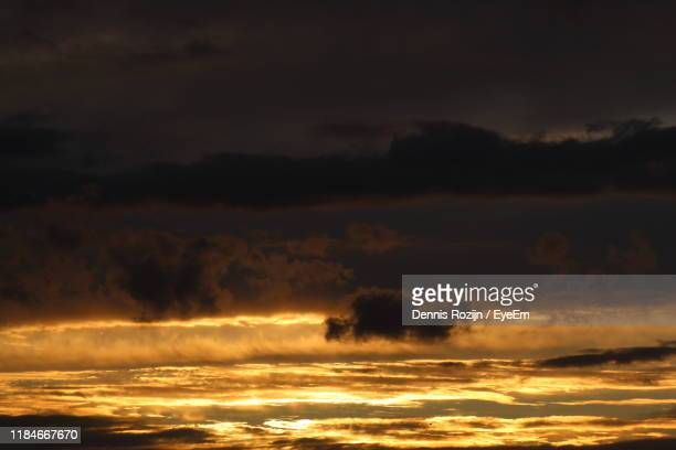 low angle view of dramatic sky during sunset - storm dennis stock pictures, royalty-free photos & images