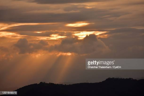low angle view of dramatic sky during sunset - chatchai thalaikham stock pictures, royalty-free photos & images