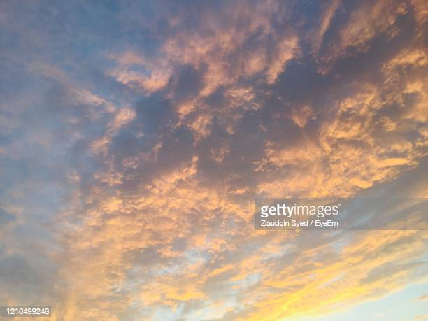low angle view of dramatic sky during sunset - mecca stock pictures, royalty-free photos & images