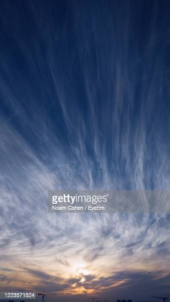 low angle view of dramatic sky during sunset - noam cohen stock pictures, royalty-free photos & images
