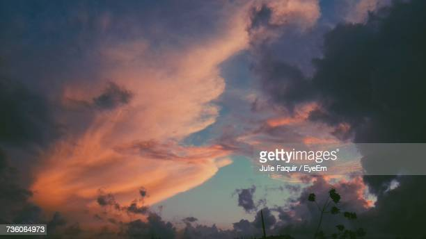 low angle view of dramatic sky during sunset - faquir stock photos and pictures