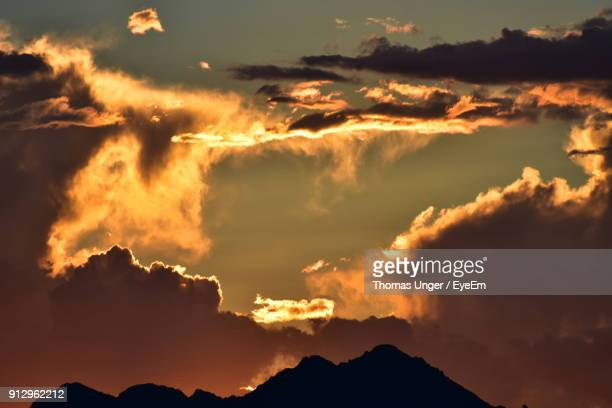 low angle view of dramatic sky during sunset - lake havasu stock photos and pictures
