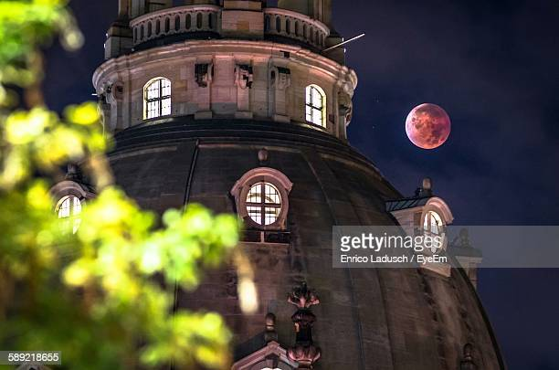 Low Angle View Of Dresden Frauenkirche Against Blood Moon Night