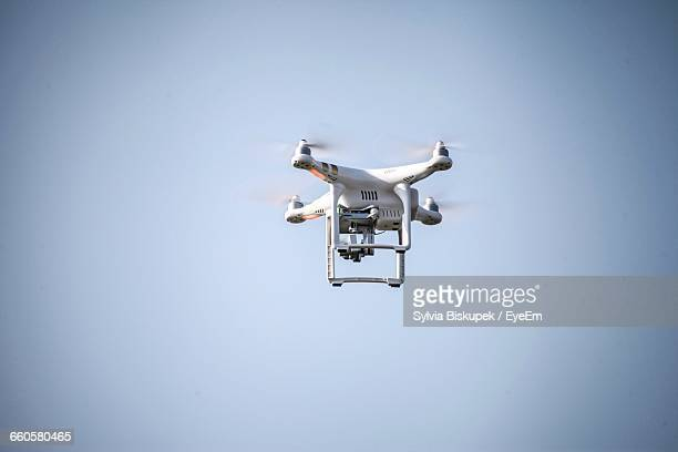 Low Angle View Of Drone Against Clear Sky