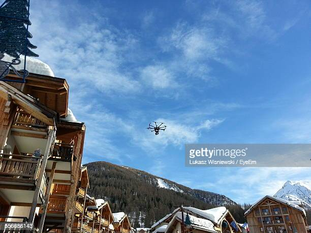 low angle view of drone flying over village - embrun stock pictures, royalty-free photos & images