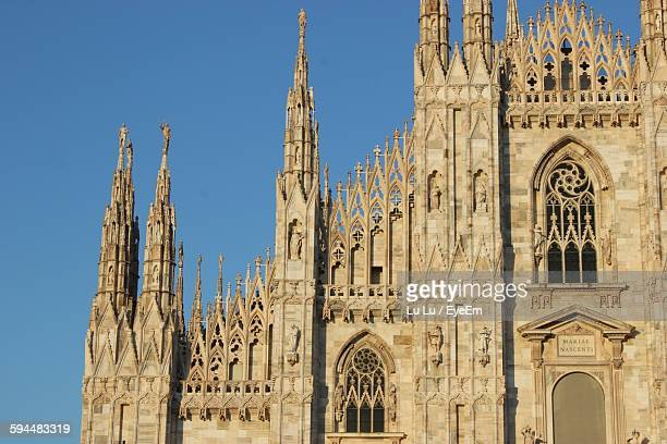 Low Angle View Of Duomo Di Milano Against Clear Blue Sky