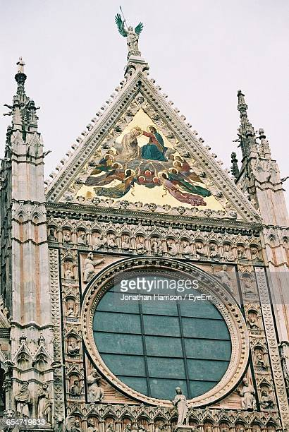 Low Angle View Of Duomo Di Siena Against Sky