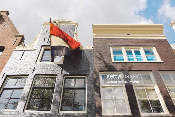 low angle view of dutch flag on building during king day - bortes stock pictures, royalty-free photos & images