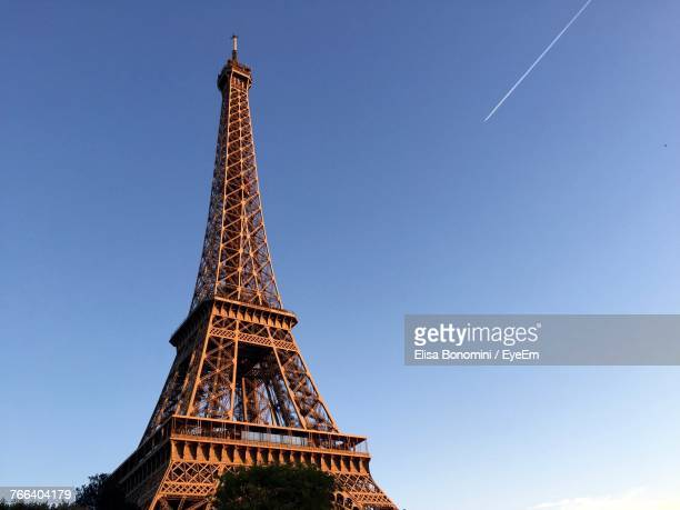 low angle view of eiffel tower against clear blue sky - eiffel tower paris stock pictures, royalty-free photos & images