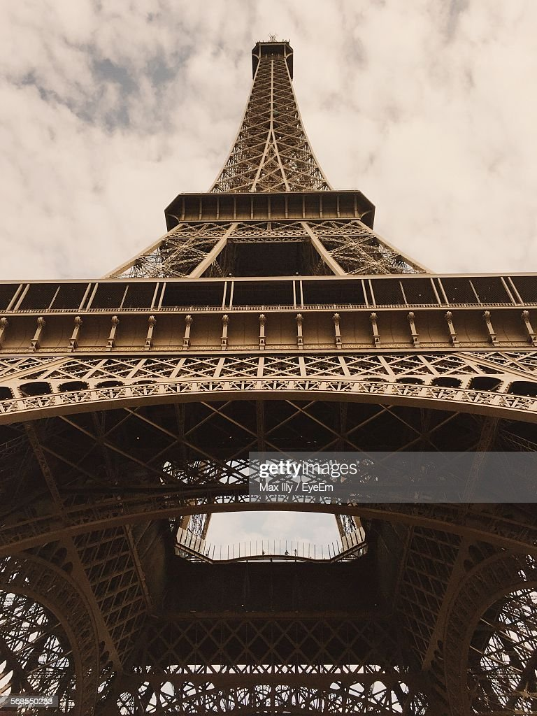 Low Angle View Of Eiffel Tower Against Cloudy Sky : Stock Photo