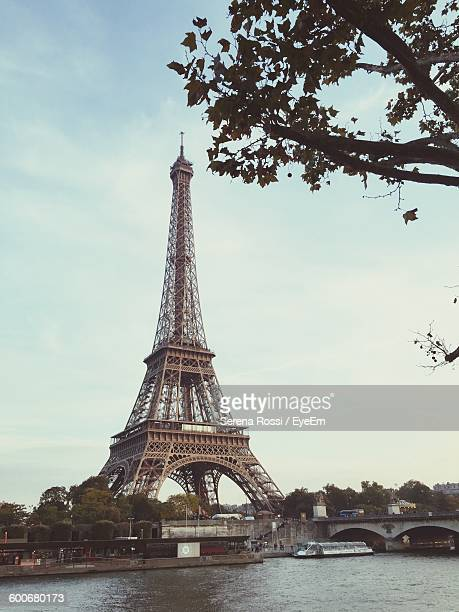Low Angle View Of Eiffel Tower In City Against Sky