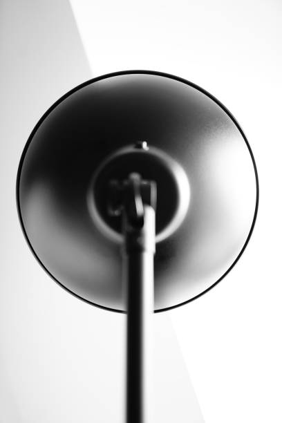 Low Angle View Of Electric Lamp Against White Background