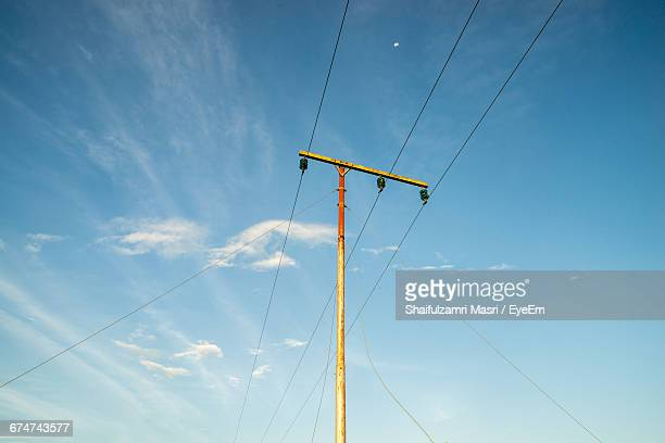 Low Angle View Of Electric Pole Against Sky