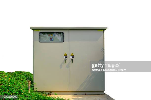 low angle view of electricity box against clear sky - electrical box stock pictures, royalty-free photos & images