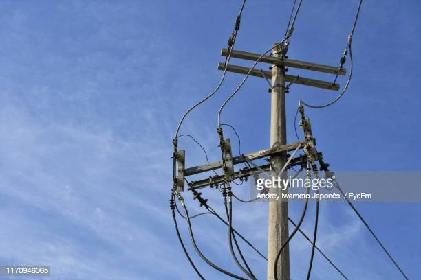 low angle view of electricity pylon against blue sky - japonês stock pictures, royalty-free photos & images