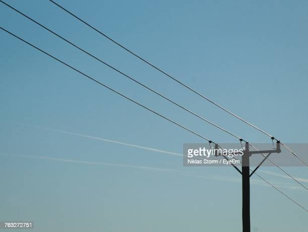 low angle view of electricity pylon against blue sky - niklas storm eyeem stock photos and pictures