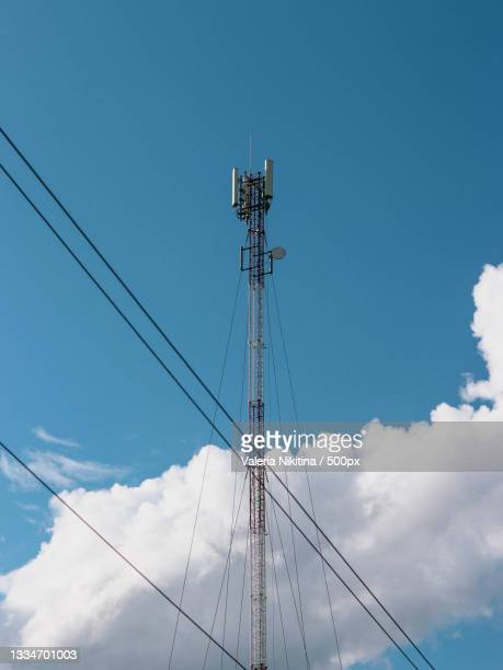 low angle view of electricity pylon against blue sky,russia - nikitina stock pictures, royalty-free photos & images