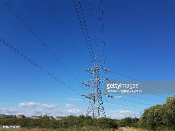 low angle view of electricity pylon against clear blue sky - newport wales photos stock pictures, royalty-free photos & images