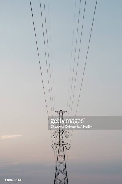 low angle view of electricity pylon against sky during sunset - power supply stock pictures, royalty-free photos & images