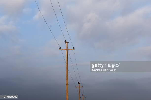 low angle view of electricity pylon against sky - treviso italy stock pictures, royalty-free photos & images