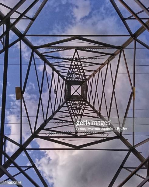 low angle view of electricity pylon against sky - japonês stock pictures, royalty-free photos & images