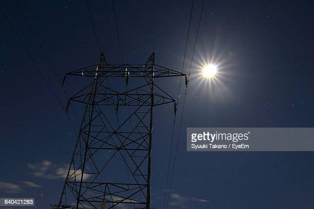 low angle view of electricity pylon against sky - 長野市 ストックフォトと画像