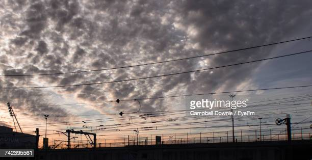 low angle view of electricity pylon against sky - campbell downie stock pictures, royalty-free photos & images