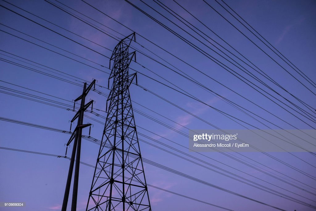 Low Angle View Of Electricity Pylon Against Sky : Bildbanksbilder