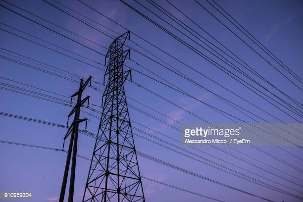 low angle view of electricity pylon against sky - alessandro miccoli stockfoto's en -beelden
