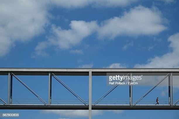 Low Angle View Of Elevated Walkway Against Cloudy Sky
