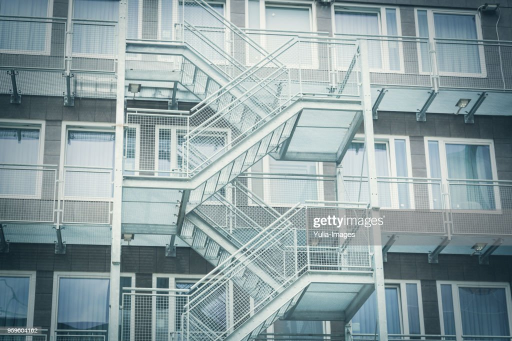 Low angle view of emergency stairs : Stock-Foto