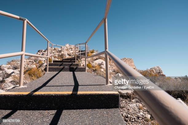 low angle view of empty steps against clear blue sky at desert on sunny day - christian soldatke stock pictures, royalty-free photos & images