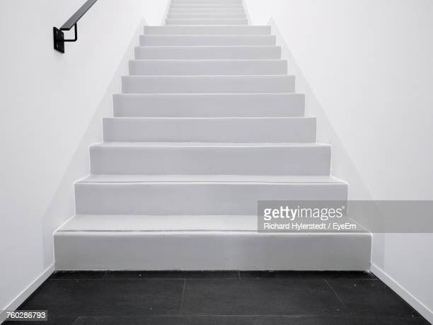 low angle view of empty steps in building - stairs stock photos and pictures