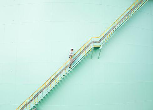 Low Angle View Of Engineer Walking On Steps - gettyimageskorea