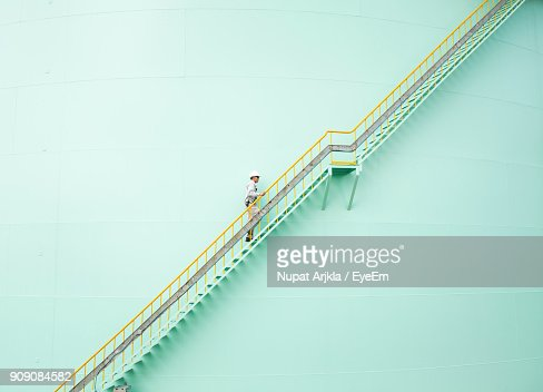 Low Angle View Of Engineer Walking On Steps
