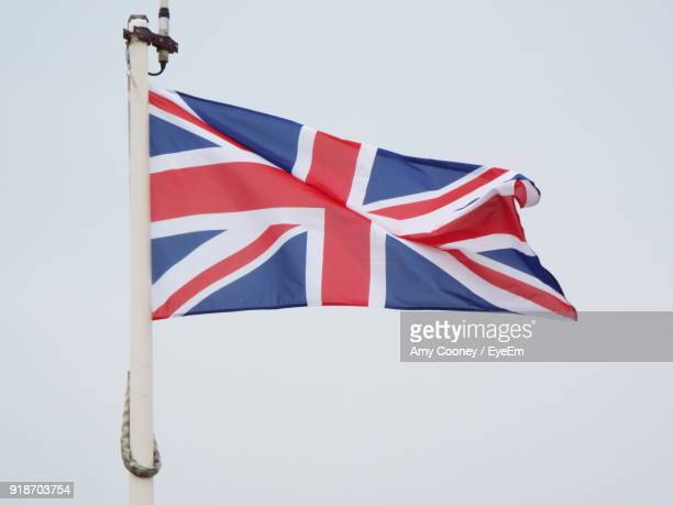 Low Angle View Of English Flag Against Clear Sky