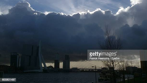 Low Angle View Of Erasmus Bridge Over River Against Cloudy Sky
