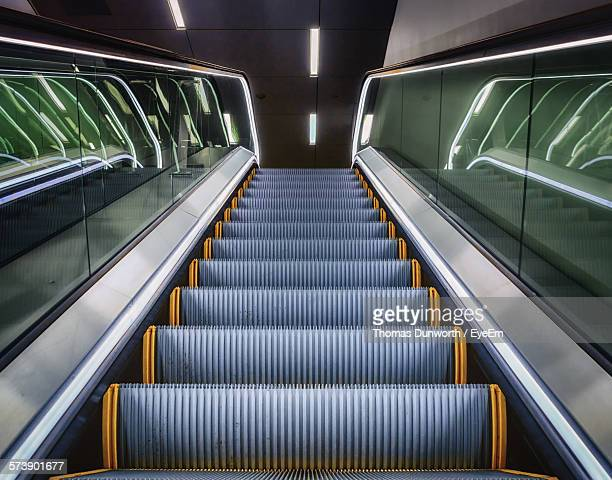 low angle view of escalator at office - escalator stock pictures, royalty-free photos & images