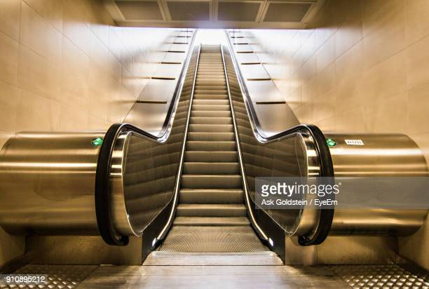 low angle view of escalator - escalator stock pictures, royalty-free photos & images