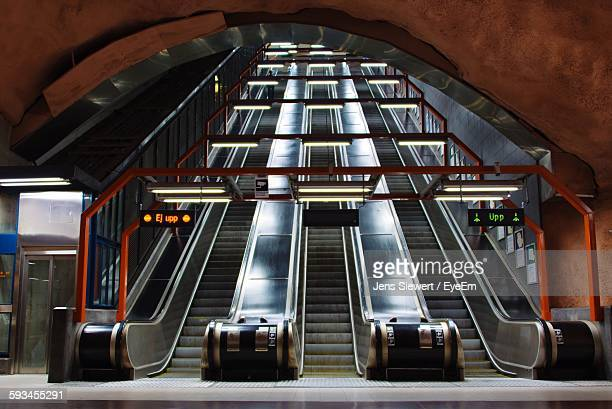 low angle view of escalators at subway station - jens siewert stock-fotos und bilder