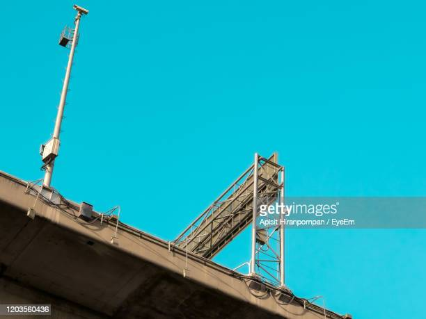 low angle view of express way against clear blue sky - apisit hiranpornpan stock pictures, royalty-free photos & images
